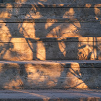 Sunset paints shadows on a staircase.